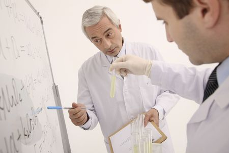 southeastern european descent: Scientists having discussion Stock Photo