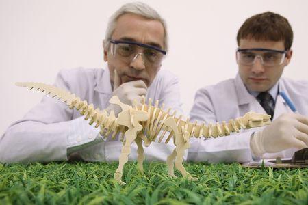 bulgarian ethnicity: Scientists examining wooden dinosaur model