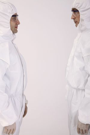 bulgarian ethnicity: Scientists in boiler suits facing each other
