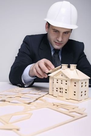bulgarian ethnicity: Man building a wooden house model