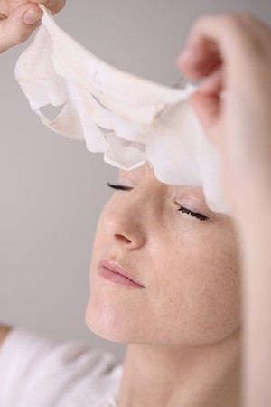 peeling: Woman peeling off her facial mask Stock Photo