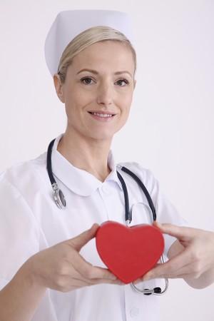 Nurse holding heart photo
