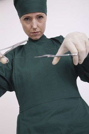 Surgeon using surgical scissors Stock Photo - 6974366