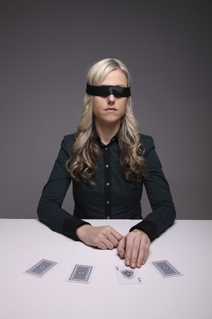 Blindfolded businesswoman playing with cards Stock Photo - 6974369