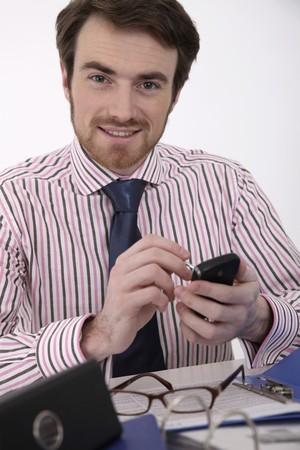 Man text messaging Stock Photo - 6974374