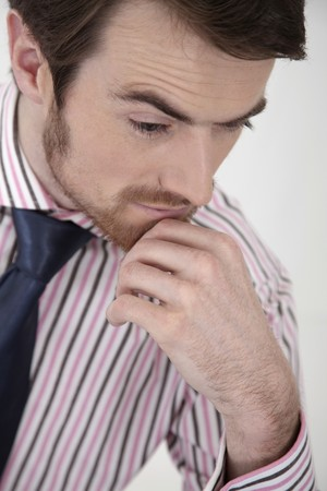 Man with hand on chin contemplating Stock Photo - 6974376