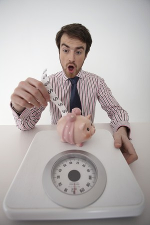 Man putting dollar note into piggy bank Stock Photo - 6990606