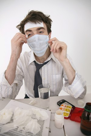 Sick man wearing surgical mask photo
