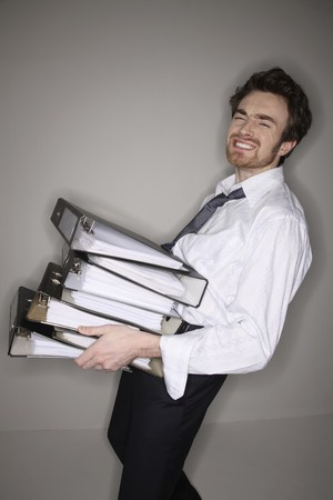north western european descent: Man carrying a stack of files