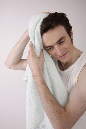 Man wiping his hair with towel Stock Photo - 6990626
