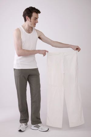 Man holding a pair of white pants Stock Photo - 6866689