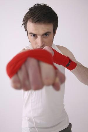 Man punching forward Stock Photo - 6990630
