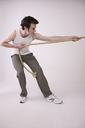 Man pulling rope Stock Photo - 6990632