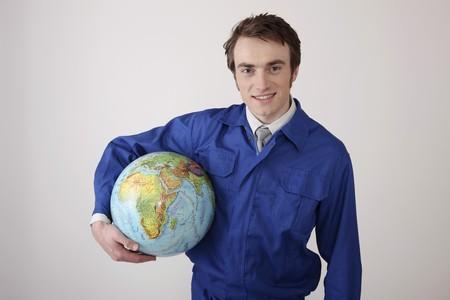 Man holding globe smiling Stock Photo - 6990637