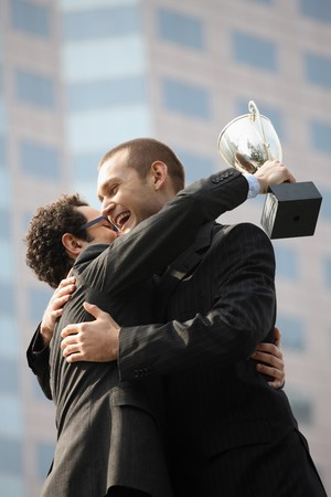 Businessmen hugging each other Stock Photo - 6990641
