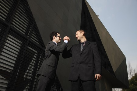 Businessmen holding hands up Stock Photo - 6990646
