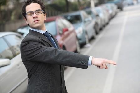 hailing: Businessman hailing taxi