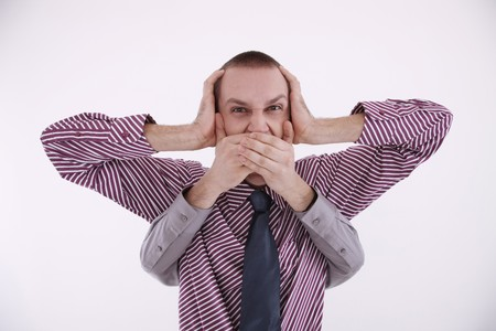eastern european ethnicity: Businessman covering ears, a pair of hands covering his mouth