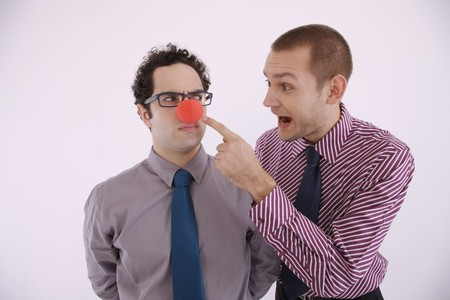 Man pointing at businessmans clowns nose photo