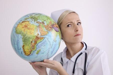 Nurse listening to a globe photo