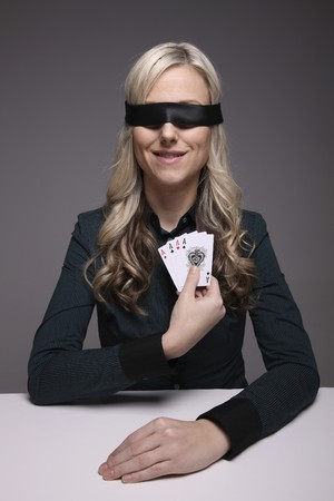Blindfolded businesswoman holding playing cards Stock Photo - 6990691