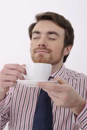 Man enjoying a cup of coffee photo