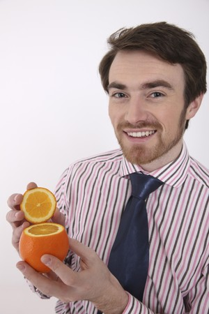 north western european descent: Man holding sliced orange