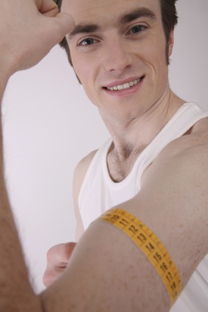 Man measuring his muscle Stock Photo - 6990722