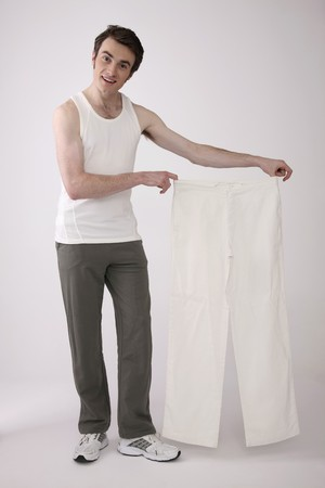 Man holding a pair of white pants Stock Photo - 6990724