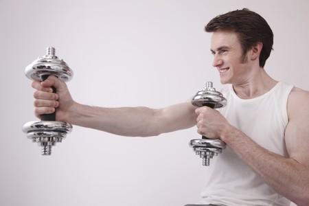 Man lifting weights Stock Photo - 6990729