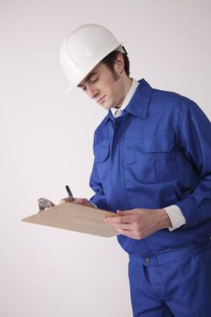 Man writing on clipboard Stock Photo - 6990730