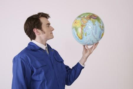 Man holding globe smiling Stock Photo - 6990734