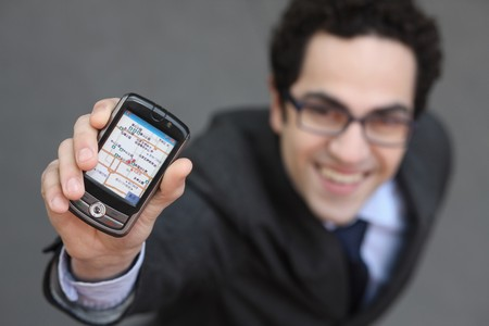 Businessman showing his mobile phone photo