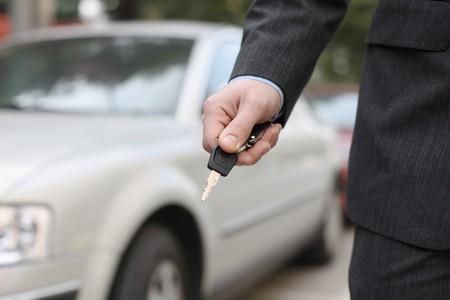 Businessman with car key photo