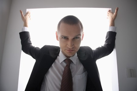 Businessman standing in doorway Stock Photo - 6990748