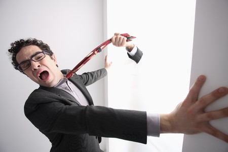 Hand pulling businessman's necktie Stock Photo - 6990749