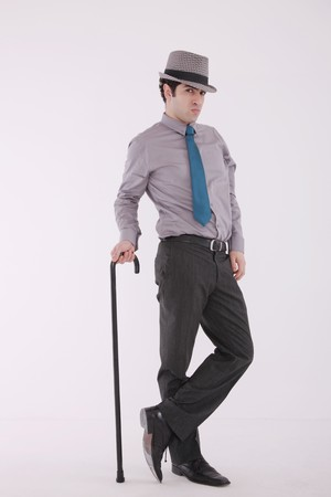fedora hat: Businessman with cane and fedora Stock Photo