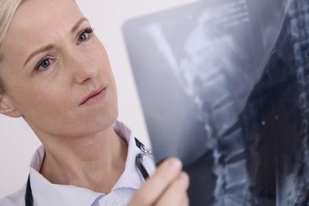 Nurse examining x-ray photo