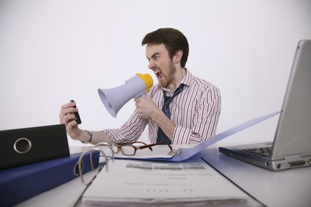 Man screaming into cellphone using megaphone Stock Photo - 6990800