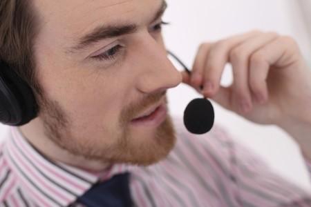 Man talking into headset Stock Photo - 6990804