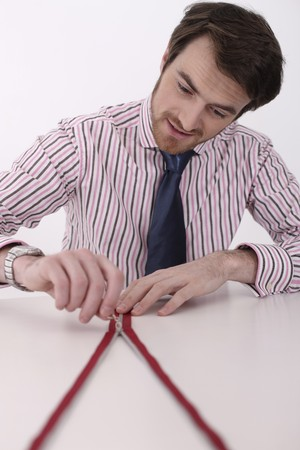 zip tie: Man zipping up zipper on the table