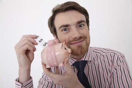 Man putting dollar note into piggy bank Stock Photo - 6990807