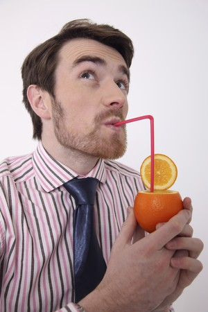 Man drinking fresh orange juice photo