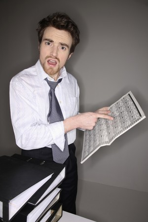 Man pointing at newspaper Stock Photo - 6990818