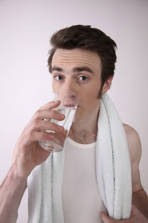 Man drinking a glass of water Stock Photo - 6990824