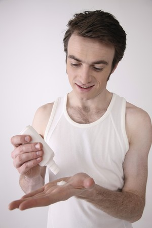 Man applying cream Stock Photo - 6990829