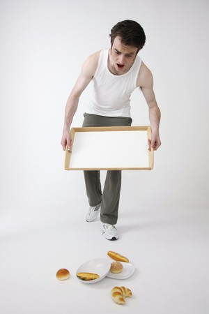 Man dropped tray with breakfast Stock Photo - 6866663