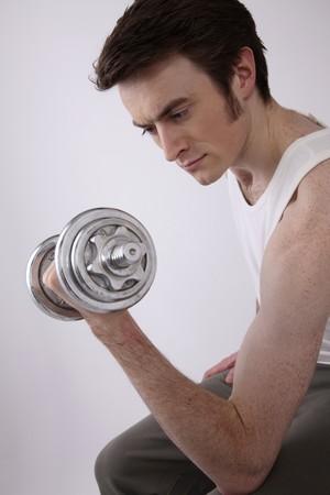 Man lifting weights Stock Photo - 6990831