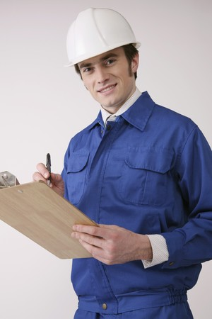 Man holding clipboard smiling Stock Photo - 6990832
