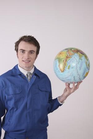 Man holding globe smiling Stock Photo - 6990836